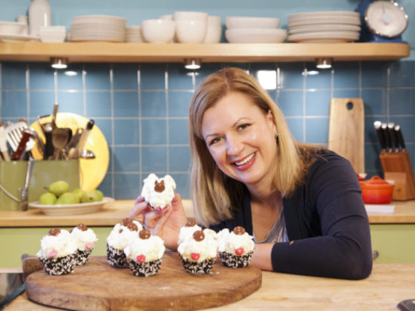 Anna Olson with puppy cupcakes