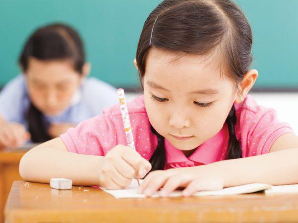 kids writing in school