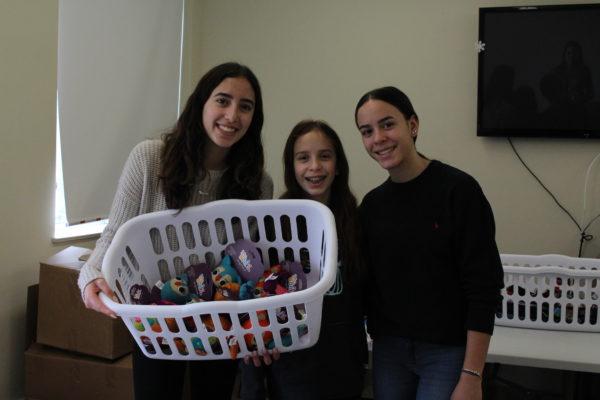 sisters, petsmart charities donation, volunteers