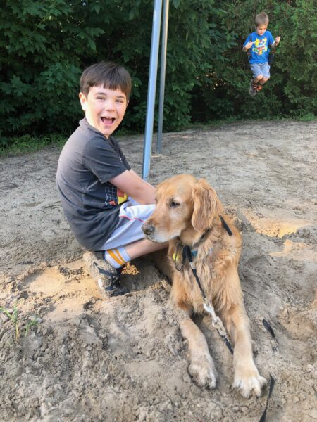 Emerson and Buddy, sand