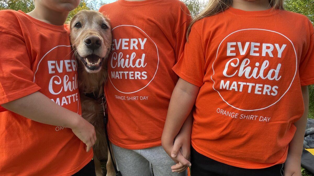 orange shirt day children and dog
